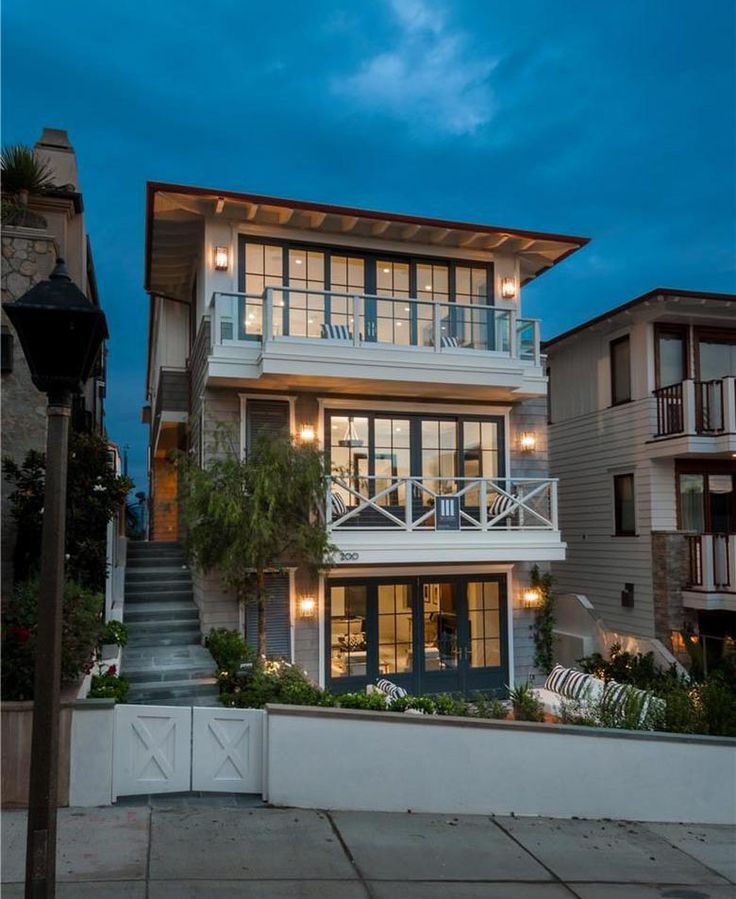 This charming Cape Cod style modern home in Manhattan Beach  California is located on one of the finest pedestrian walk streets a short to town or 158 best beach house narrow lot plans images Pinterest Modern