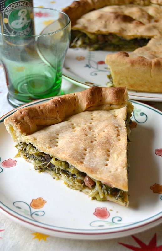 PIZZA DI SCAROLA (Campania) is a fragrant pizza stuffed with a filling made of escarole, cooked in a pan along with anchovies, capers and olives #food #pizza