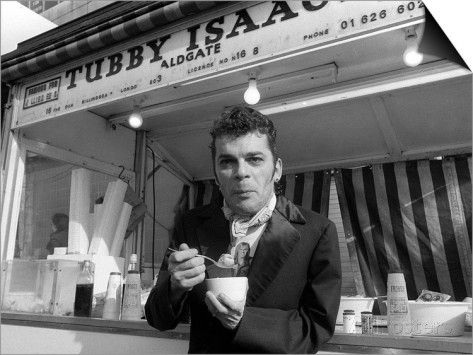 Ian Dury Outside the East End Stall of Tubby Isaacs Eating Bowl of Jellied Eels SwitchArt™ Print
