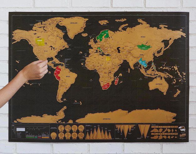 A scratch-off world map that will reveal its colors over the years. | 57 Of The Most Amazing Gifts Of 2016