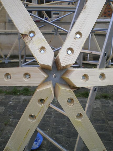 Geodesic dome connector. I have only built one dome, and that was back in the youth of my carpentry career. There were three of us building it, which was a number that worked well with the project. We prefabricated all of the panels, and then assembled it. It was large, with a 20' radius. I appreciated all of the geometry, amd trigonometry that I had studied. It was fasciating as it came together and quite beautiful. McC