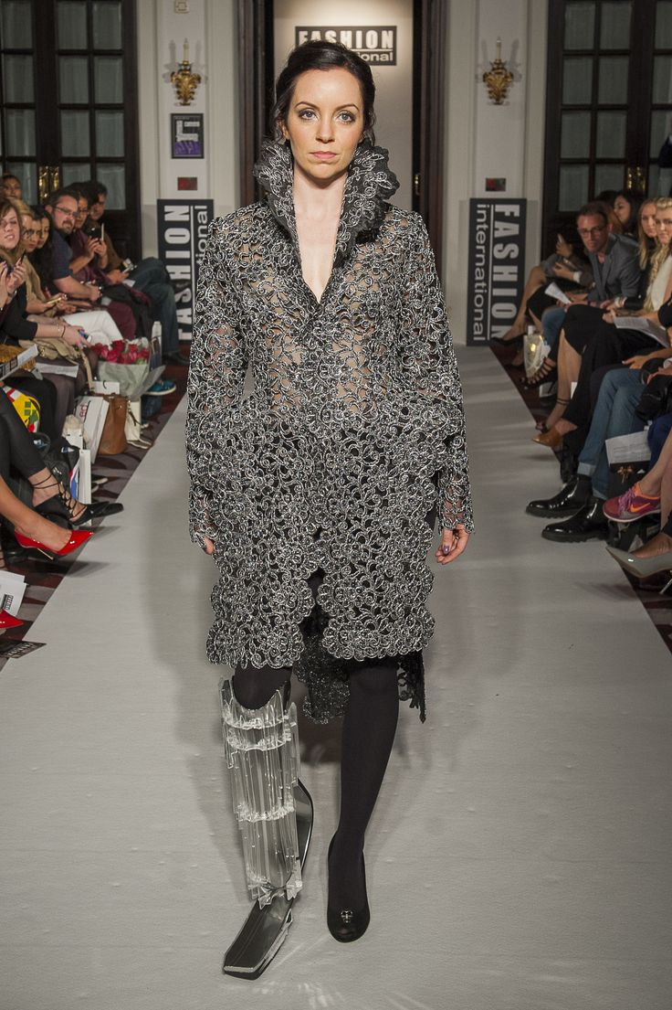 "Lenie Boya ""Dramatique"" Collection at London Fashion Week S/S 2016 Haute Couture. Futuristic metallic silver laser cut lace coat, with 3D rectangular hips and high collar."