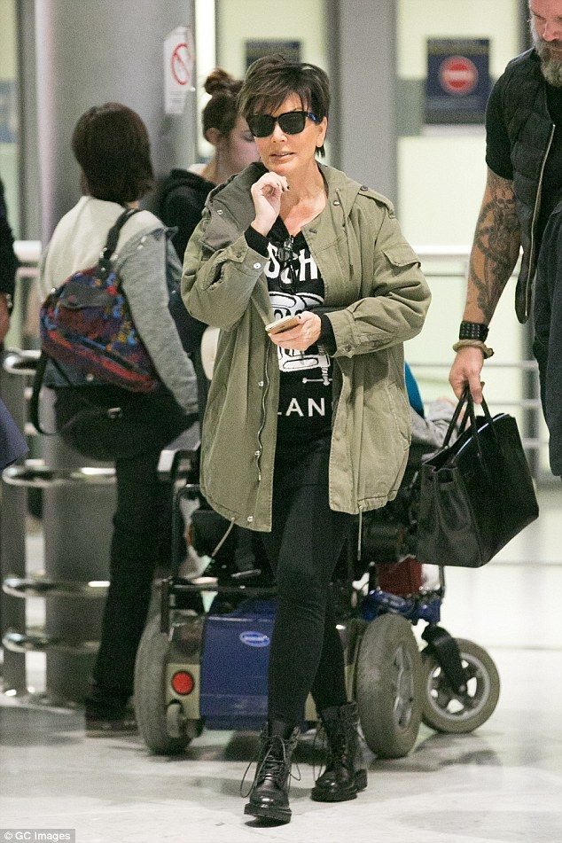 Busy week: The 'momager' looked relaxed as she walked through the terminal, after spending the past week in the French capital for Paris Fashion Week with her toyboy partner