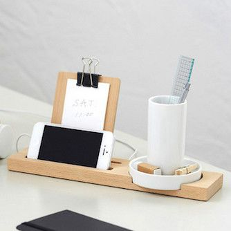 The tray contains a white cubby – which houses pens, paper clips, and other small items – a memo pad, and a smartphone stand.