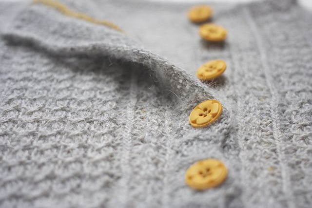 Ravelry: capovak's Eivor - a child cardigan, false cables, steeked. Made from Mafil Paracas.