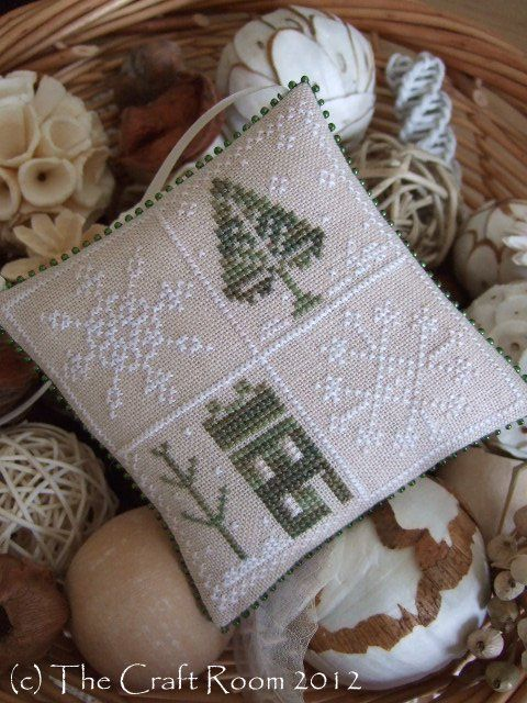 Wonderful pick-up project for quiet, snowy winter days ,, tiny cross-stitched pillow tucks