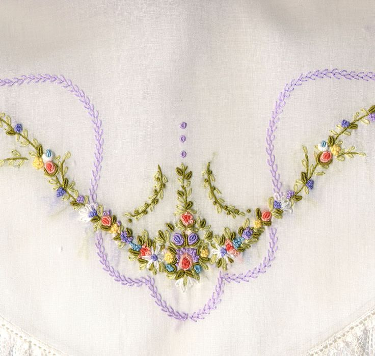 Lavender featherstitch winds around an arrangement of embroidered flowers and greenery.  From Collar Package #3 by Collars, Etc. Pattern Co.  Made by Trudy Horne.