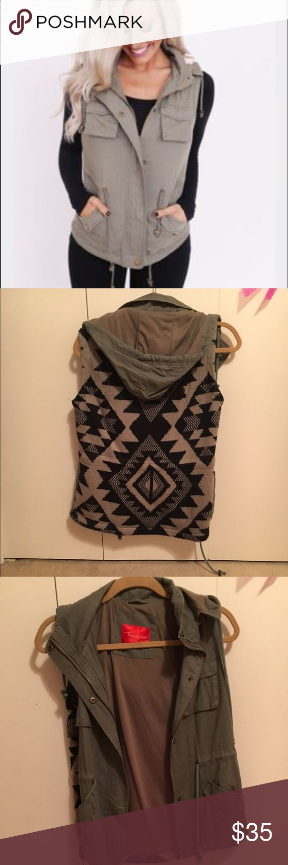 Olive vest Vest from Dottie couture boutique. Print on the back. Detachable hood. Perfect for fall! Only worn once. Dottie couture boutique Tops