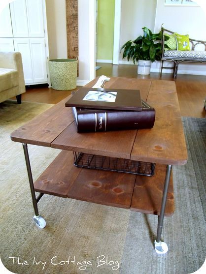 pipe and reclaimed lumber coffee table on casters. i like the idea and the diy instructions. would use iron pipe instead of copper (costs less) and dark casters. those white ones look undersized, not sturdy and just not industrial enough for the concept.