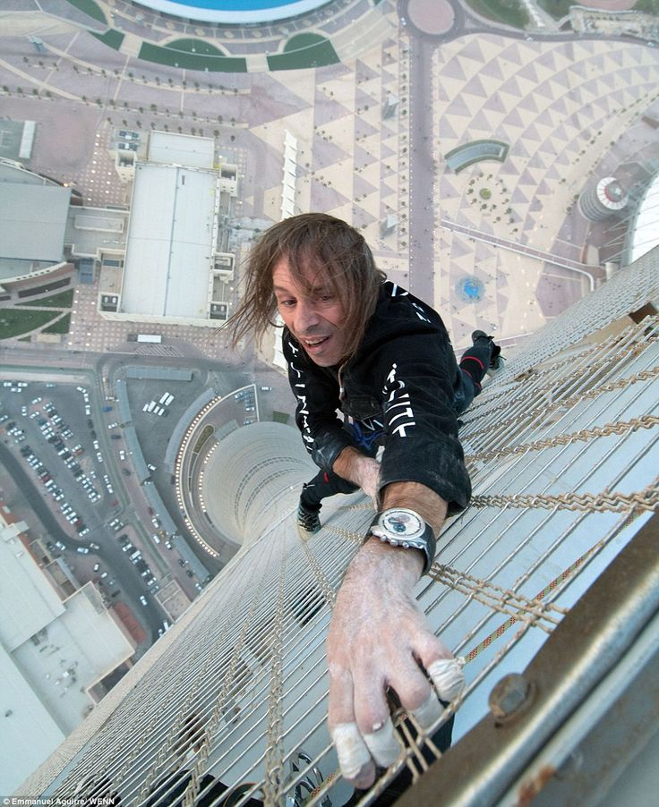 "Alain Robert - is a Frechman with an unusual hobby: he free climbs the world's tallest buildings. Urban climbing (or ""buildering"" as some call it) has been around for over a hundred years, but has achieved greater exposure over the last couple decades thanks to globalized media. It's usually done barehanded, without ropes or safety equipment, mostly because climbing buildings is illegal in most major cities."