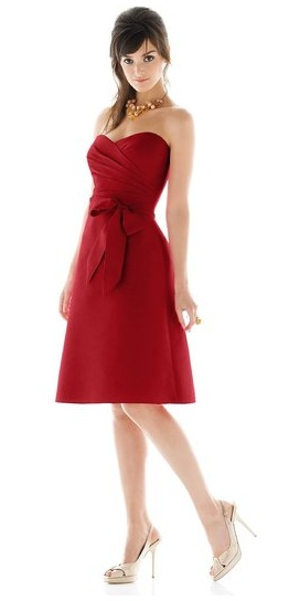 Style D437 is a sweetheart, cocktail length, bridesmaid dress by Alfred Sung. Made in a gorgeous peau de soie, it features a draped bodice and a matching sash. $158 www.weddingtonway.com