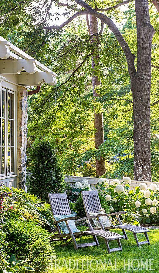 Wooden lounge chairs in a stunning backyard - Photo: Rob Cardillo / Landscape Design: Meg Turner