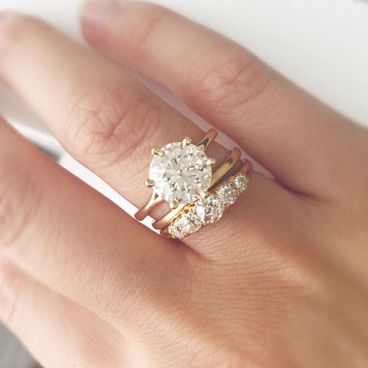 The Marilyn ring features a STUNNING 2.80 carat old European cut diamond set in an 18kt yellow gold 6 prong setting. Shown paired with a thin gold band and the Francesca 5 stone Victorian ring!