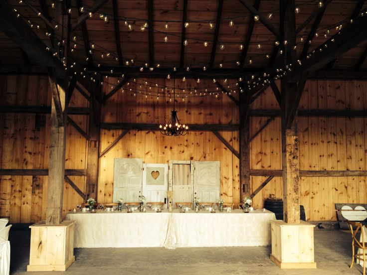 Beautiful head table in barn, full lighting included with each package including LED back lite lights throughout.