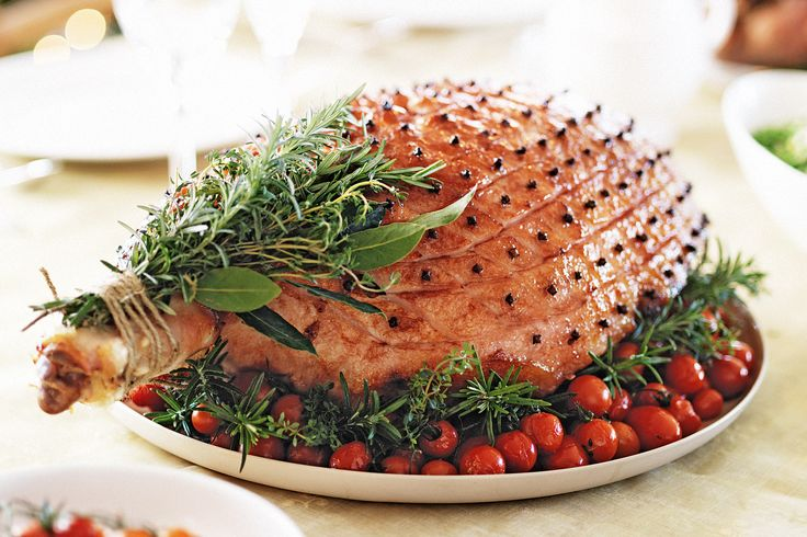 Let this honey-glazed ham decorated with aromatic herbs double as your Christmas table centrepiece before carving thick slices.