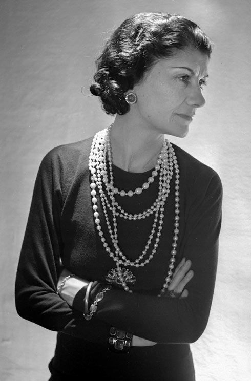 Coco Chanel wearing multiple strands of pearl jewelry