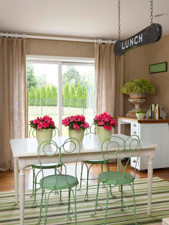 One-of-a-kind pieces imbue a home with warmth and character, so let your collections and favorite finds guide your color palette and bring a sense of order to eclectic vintage treasures. In this serene dining room, old metal soda shoppe chairs contribute a minty green to the neutral palette. Underfoot, a striped rug adds additional shades of green for depth. The old desk and table share a fresh finish of white paint, while the taupe walls put the focus on the furnishings./