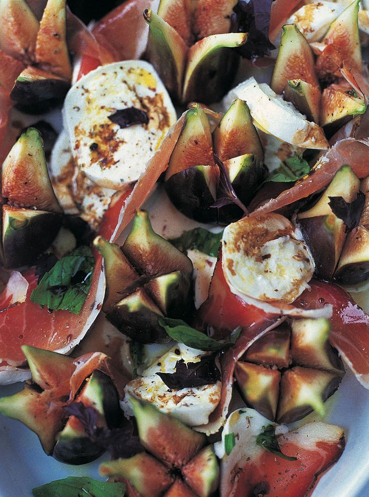 easiest sexiest salad in the world   4 figs  4 slices quality Parma ham or prosciutto  buffalo mozzarella  green or purple basil  6 tablespoons extra virgin olive oil  3 tablespoons lemon juice  1 tablespoon honey  sea salt  freshly ground black pepper      Jamie Oliver | Food | Jamie Oliver (UK)