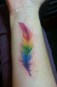 Rainbow feather tattoo