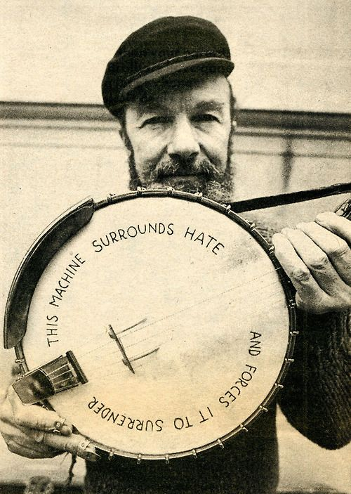 "Pete Seeger photographed by Annie Leibovitz. ""This machine surrounds hate and forces it to surrender."" (Seeger's banjo is the counterpoint to Woody Guthrie's guitar that was marked: This machine kills fascists. rw)"