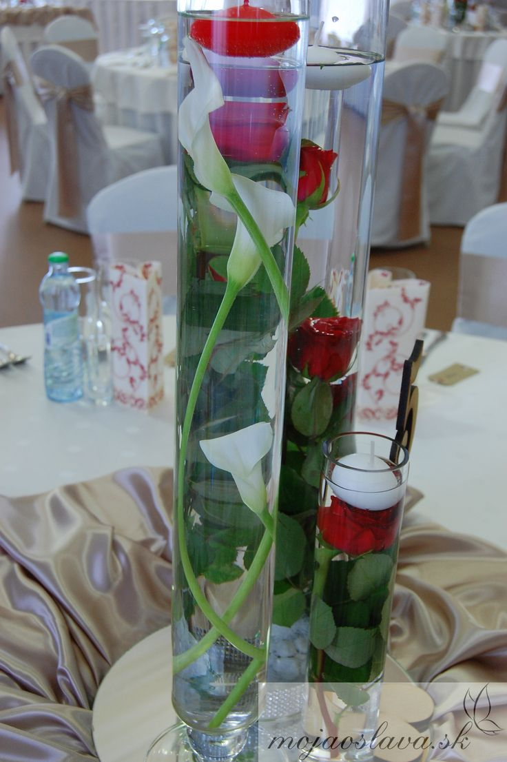 white kala with red roses under water