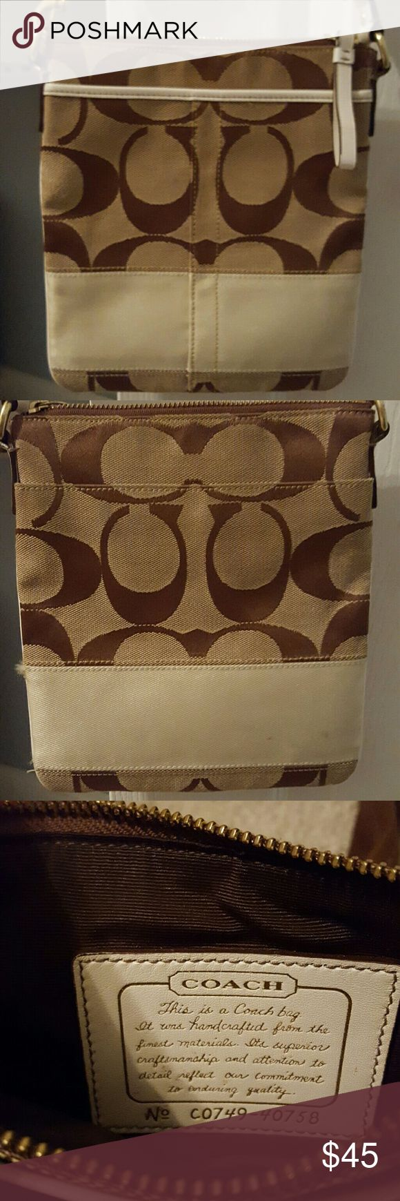 Coach swingpack bag Brown medium bag with two exterior pockets and a shoulder pad when you use the adjustable strap to make it a crossbody, or it can be worn on one shoulder, great for shopping and travelling. Coach Bags Crossbody Bags