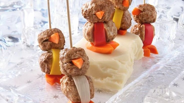 "Frozen cooked meatballs become tasty party penguins thanks to carrot ""beaks"" and ""flippers."""