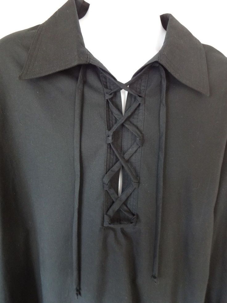 """A new pirate peasant poet colonial shirt. This black classic design shirt has the long gathered sleeves with button cuff. Front lace-up neck opening New not worn. Black cotton fabric. Size L is for a 42"""" to 44"""" chest. 