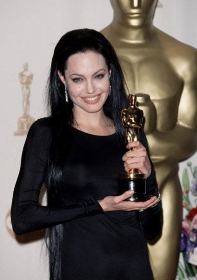 WORST: At the 72nd Annual Academy Awards, Angelina Jolie looked like Elvira, wearing her jet-black hair below her waist, and giving herself pungent, black cat-eyes.