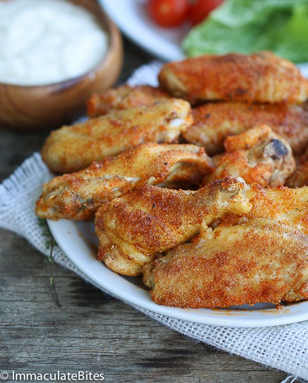 Baked Crispy Chicken Wings -A deliciously crispy  chicken wing  and you won't believe they are baked and the best part? You  won't feel bad  indulging  in them.