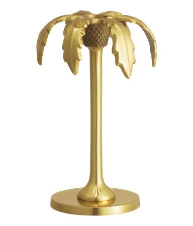Palm tree-shaped candlestick in antique-finish metal. Height 7 3/4 in., diameter at base 3 1/2 in.