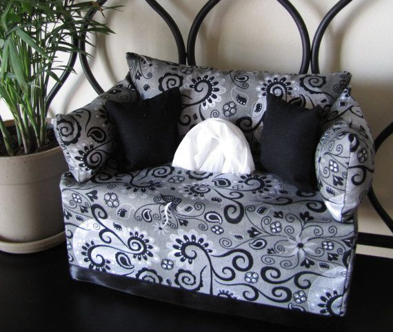 I want to find Pillows in this black, white and grey pattern for the white leather couch at the gallery to bring in Chris' contemporary side to the party.