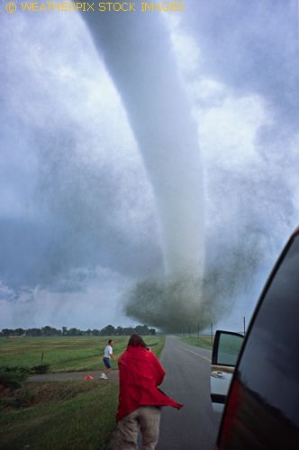 A photographer captures the deployment of a scientific weather probe in the path of an oncoming tornado near Manchester South Dakota on June 24th, 2003. An astounding pressure drop of 100 millibars was recorded as the tornado passed over the device.