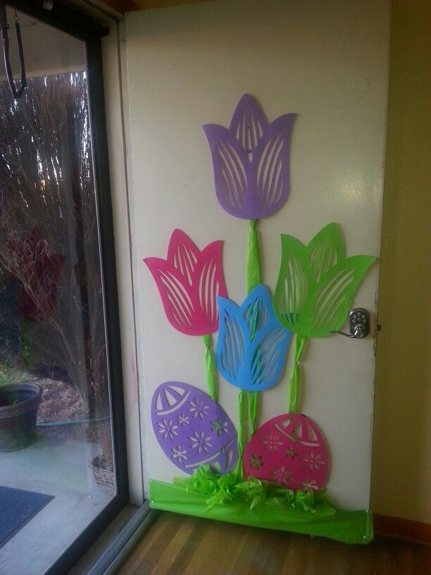 Spring door decoration... Used tullips and eggs from dollar tree $1 each... and green table cloth ... needs a quote then it should be done... looks like it will be good for a picture background ..
