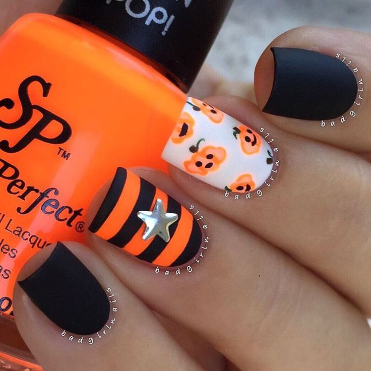 """Matte neon And more stripes Jack O' Lantern nails featuring @Salon Perfect…"