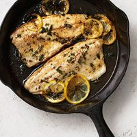 Trout with lemon and herbs in a cast iron skillet