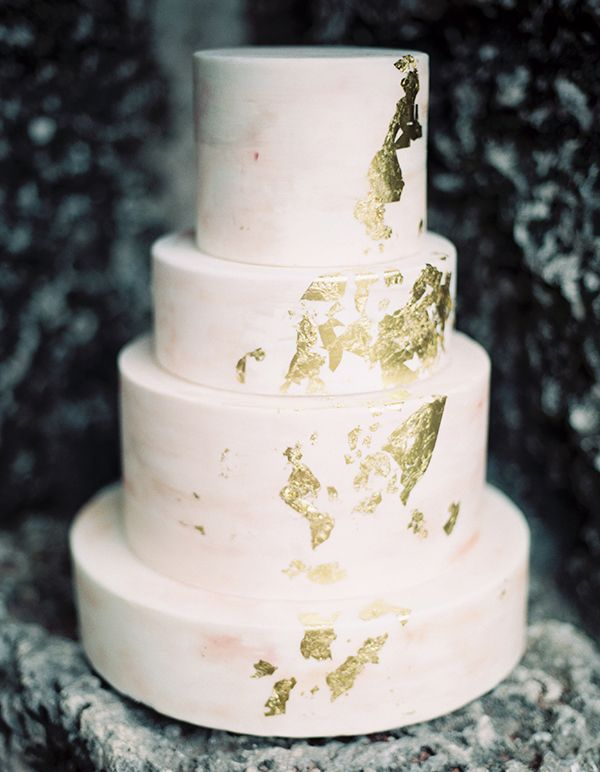 With its stony texture and flecks of gold leaf, this Earth and Sugar cake is reminiscent of a gold-veined mineral specimen.