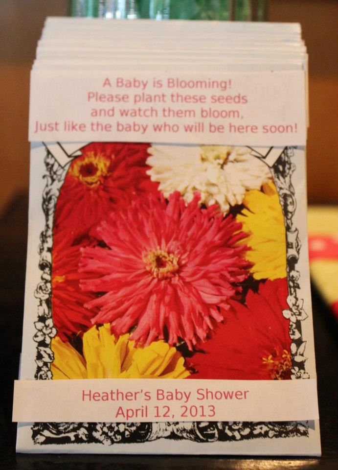 "Flower seed packets/party favors: Zinnias that say: ""A Baby is Blooming! Please plant these seeds and watch them bloom, Just like the baby who will be here soon!"" -cev"