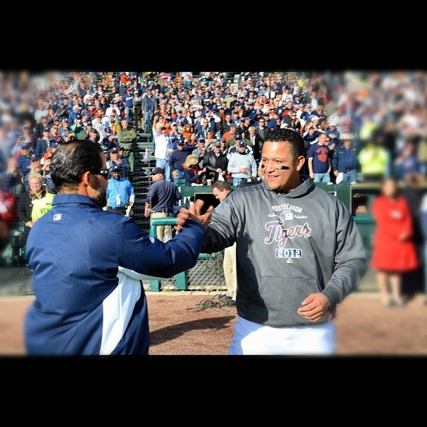Pudge Rodriguez and Miguel Cabrera share a laugh after Pudge threw out the first pitch before today's game. :')