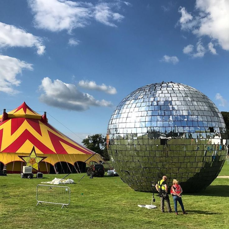 The World's Largest Disco Ball has landed at #CampBestival watch out for Big Discos by Sara Cox Bez Clint Boon Rob da Bank with Ubercorn (Go Jetters) and more! #Discoball #Mirrorball #BigDiscos #LulworthCastle