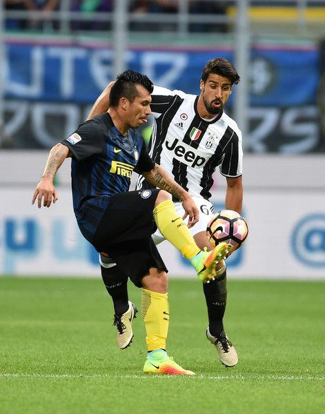 (L-R) Gary Medel of FC Internazionale competes for the ball with Sami Khedira of…