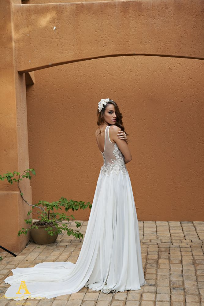 Flowy Chiffon Wedding Gown with a Fusion of Lace detail on a Sheer Bodice.