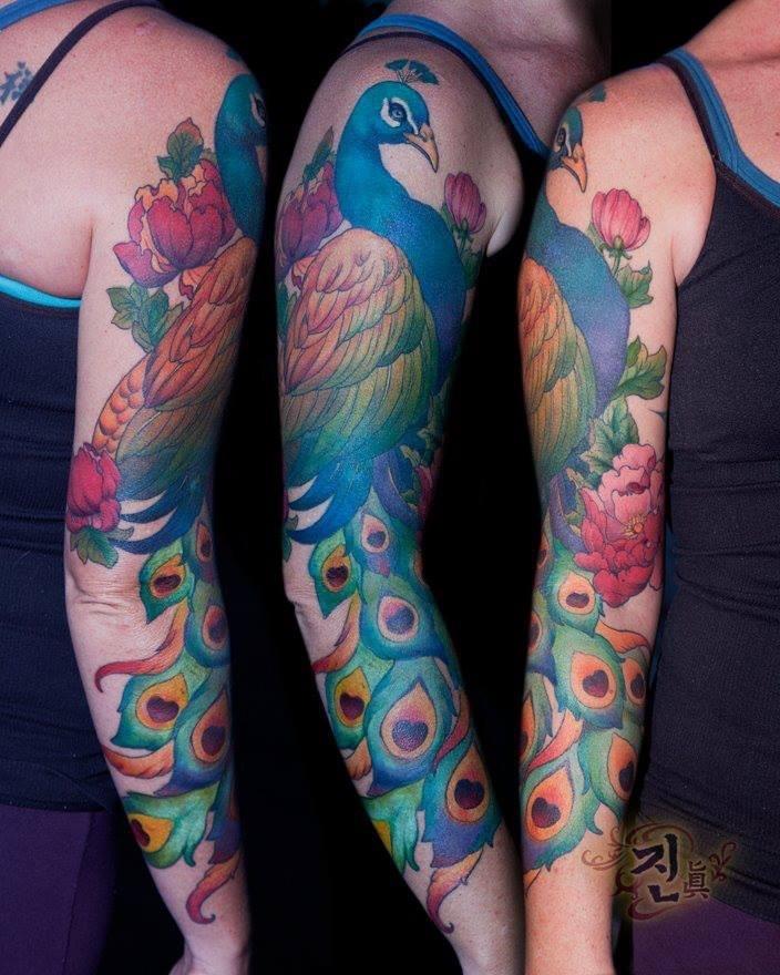 Beautiful colour work by Jin Suk O of Kaleidoscope Tattoo