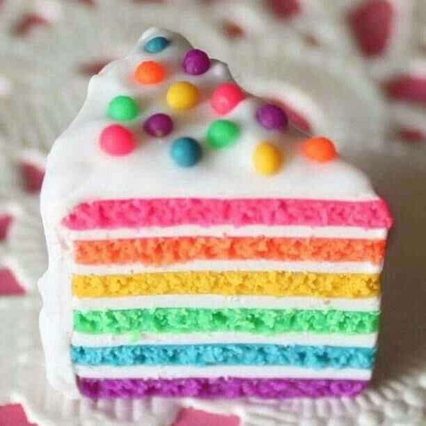 A slice of Pastel Rainbow cake #pastelrainbow #rainbowcake #cakes