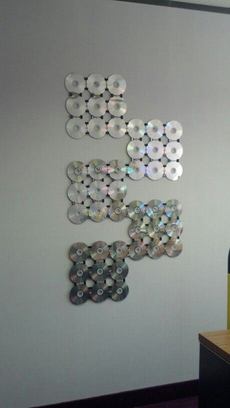 CDs and binder clips-office wall art.