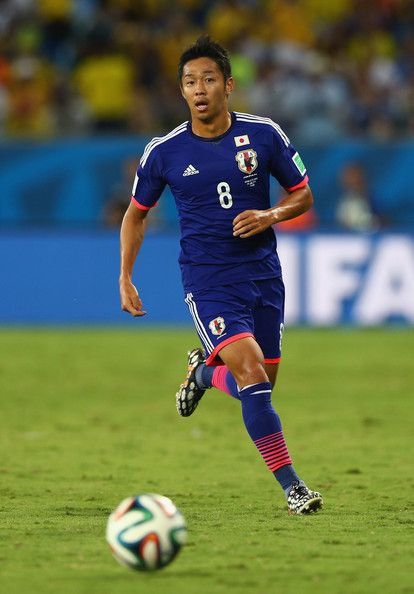 Hiroshi Kiyotake Photos - Hiroshi Kiyotake of Japan on the ball during the 2014 FIFA World Cup Brazil Group C match between Japan and Colombia at Arena Pantanal on June 24, 2014 in Cuiaba, Brazil. - Japan v Colombia: Group C