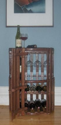 Scott thought I was crazy with my idea to turn the lobster trap into a wine cabinet . . . but it's been done by www.TrapWorks.com