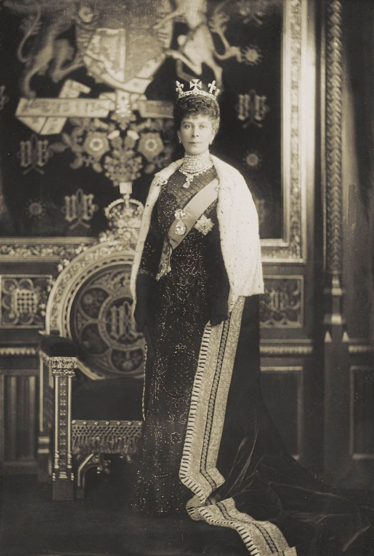 Queen Mary in the House of Lords wearing State Robes for