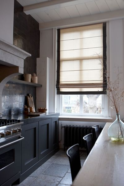A narrow space, with linen blind ~ Kitchen