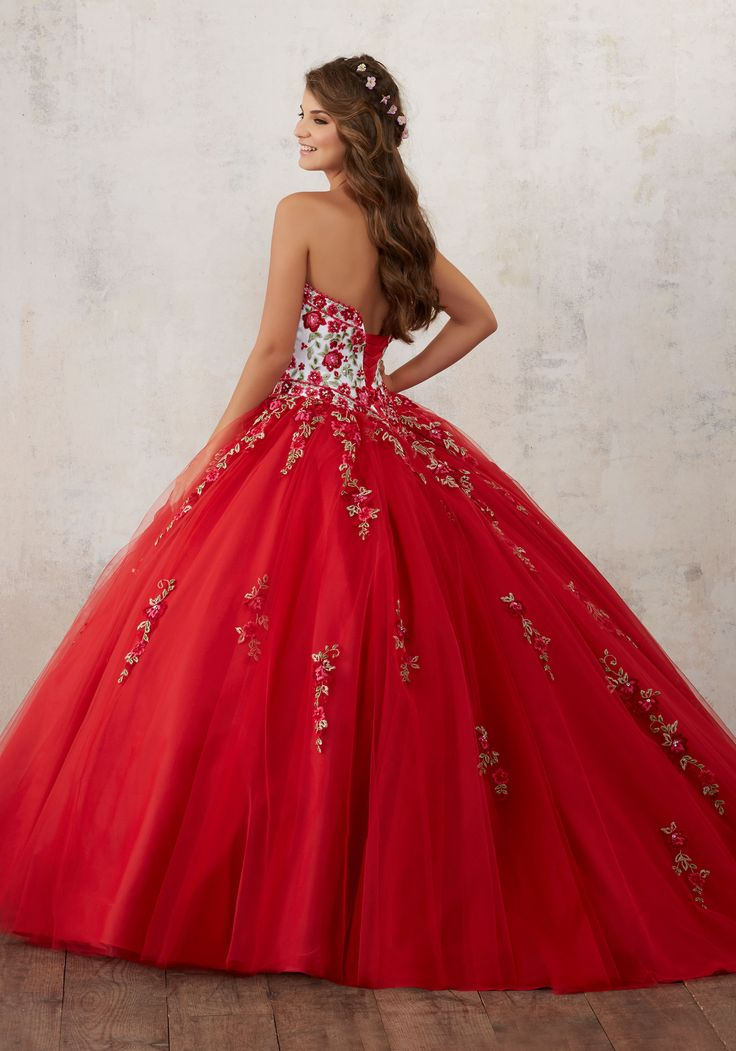 Quinceanera Dresses by Morilee designed by Madeline Gardner. Gorgeous Floral Embroidey Takes Center Stage on This Tulle Quinceañera Dress with Corset Back.